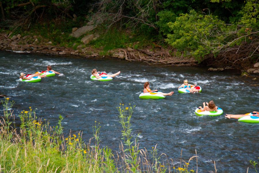 Seven women river tubing on the Root River in southern Minnesota