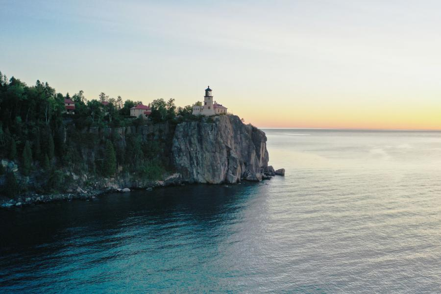 Split Rock Lighthouse looks out over Lake Superior at sunset