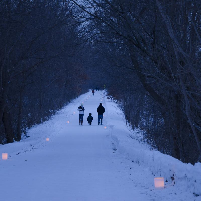 A winter walk by candlelight along the Gateway State Trail