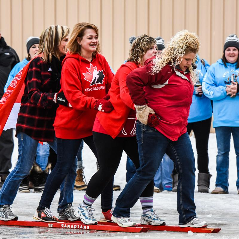 People smooshing at IceBox Days in International Falls
