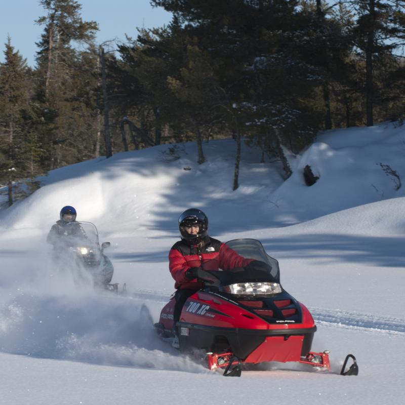 Snowmobiling on trails in Voyageurs National parkP