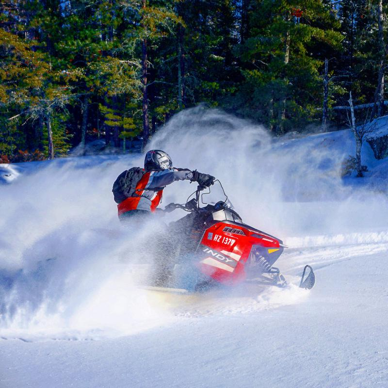 Snowmobiling on trails in Voyageurs National Park
