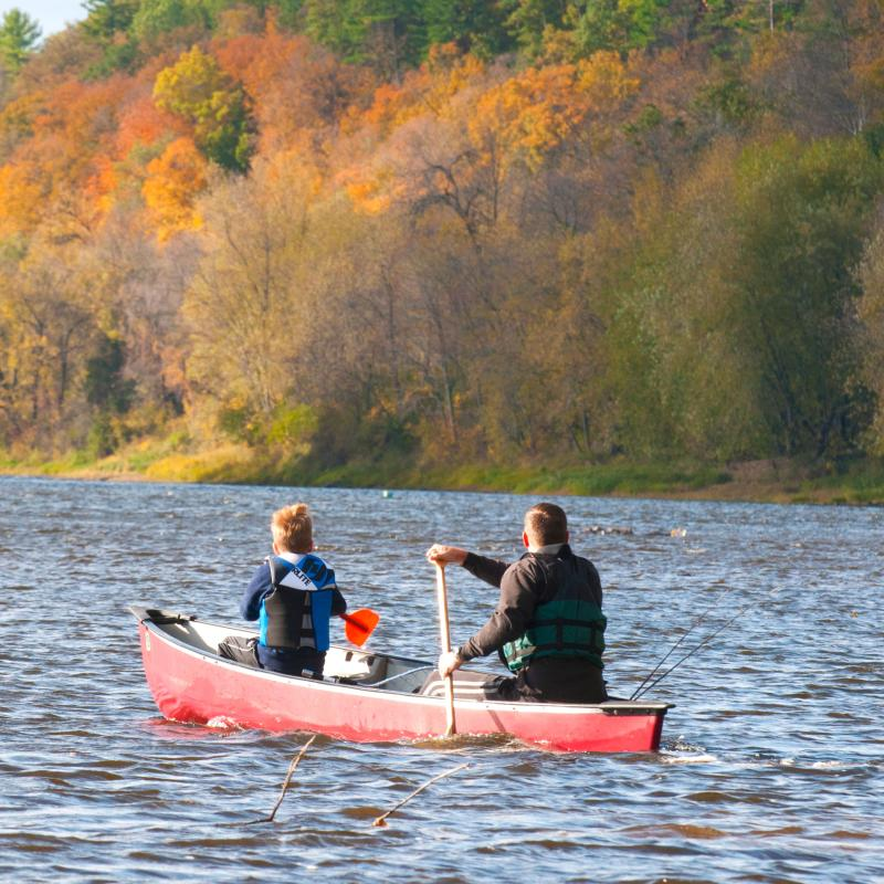Father and son canoeing in the fall