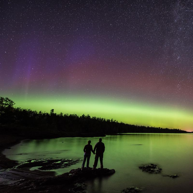 A couple watches the northern lights at Gooseberry Falls State Park