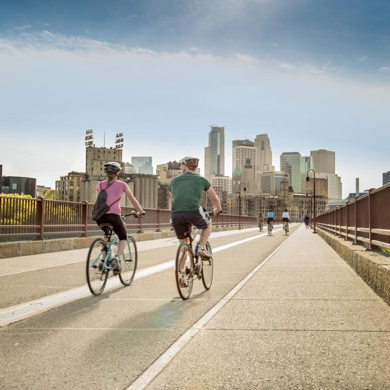 Two bikers on the Stone Arch Bridge in Minneapolis