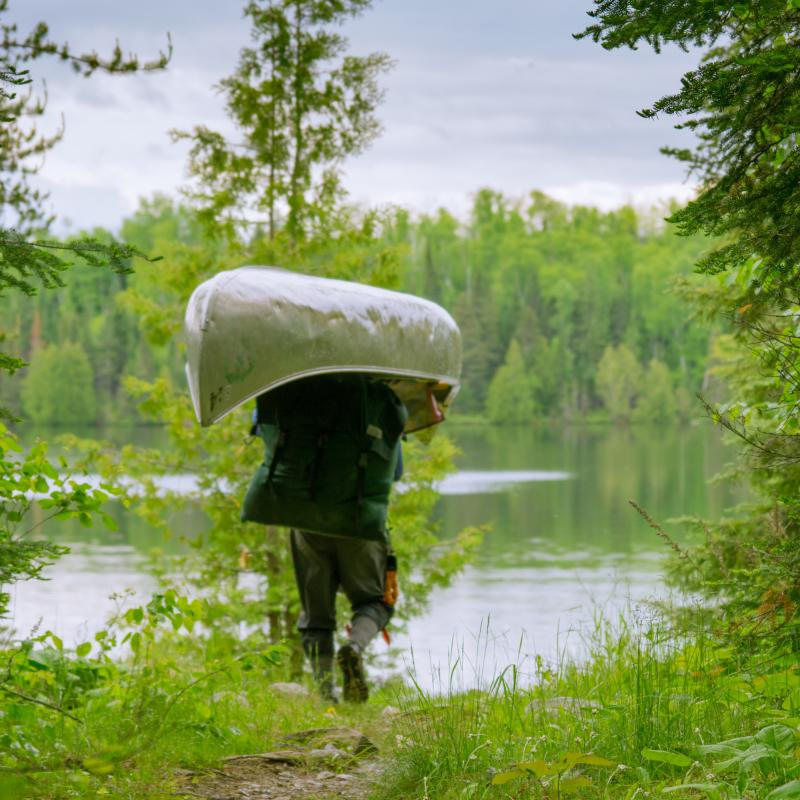 Portaging a canoe in the Boundary Waters