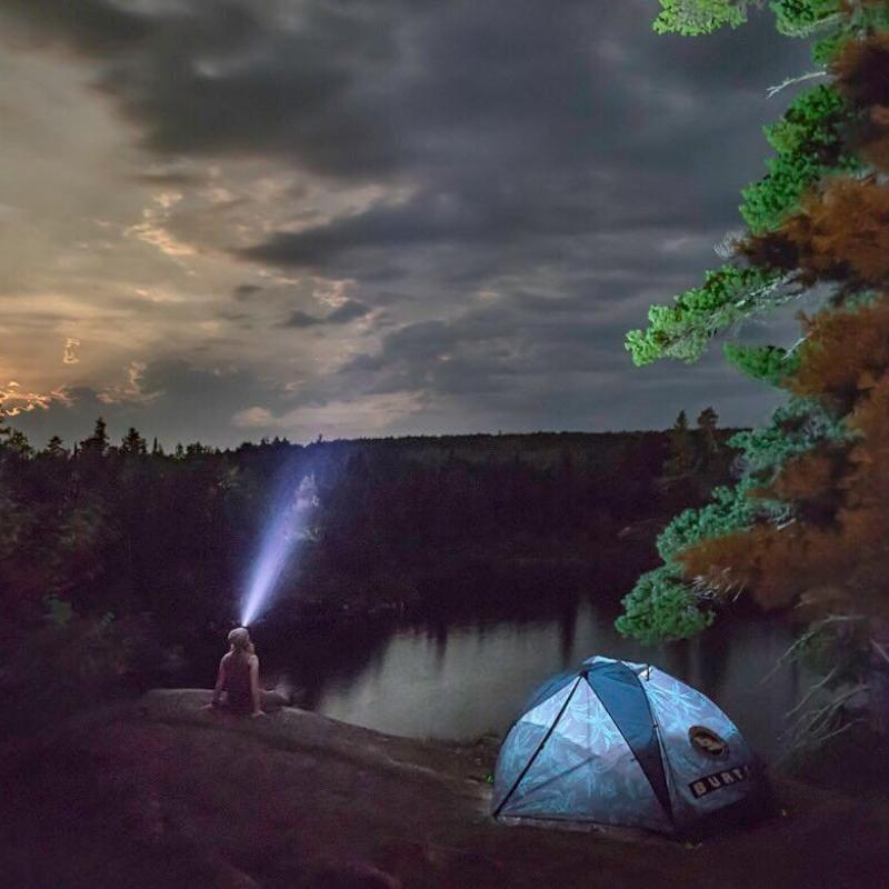 Camper with headlamp in the Boundary Waters