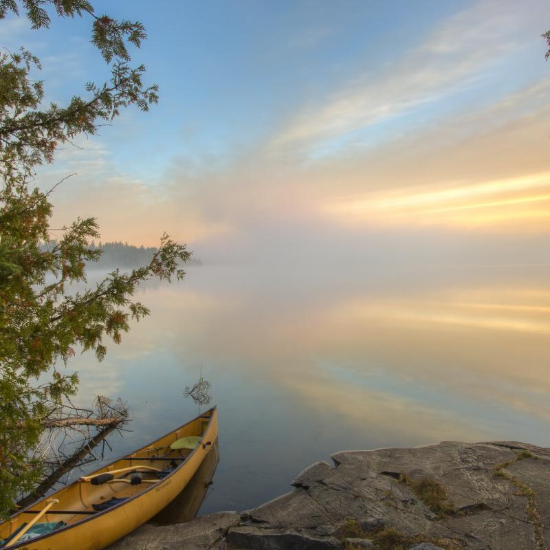 A canoe at sunrise on Ester Lake in the Boundary Waters