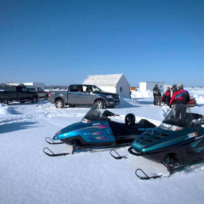 Ice fishing houses and snowmobiles on Rainy Lake