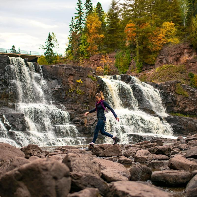 Woman hiking at Gooseberry Falls State Park