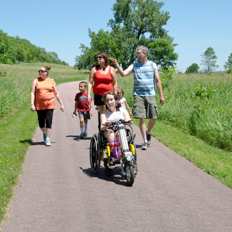Family on wheelchair-accessible trail at Blue Mounds State Park