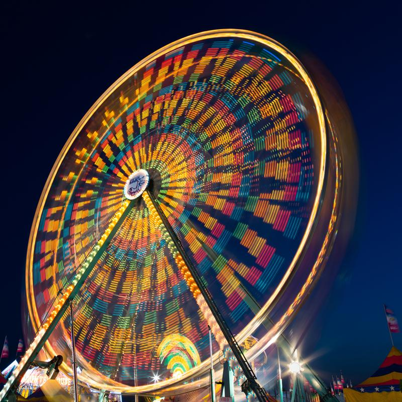 A ferris wheel at the Minnesota State Fair lights up the night