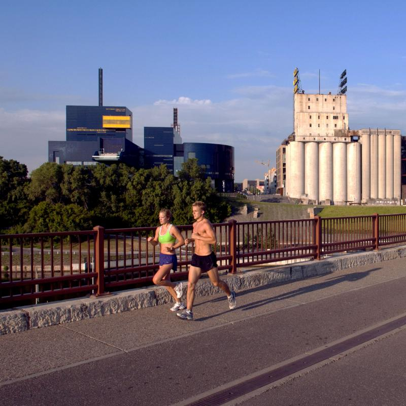 Two runners on the Stone Arch Bridge