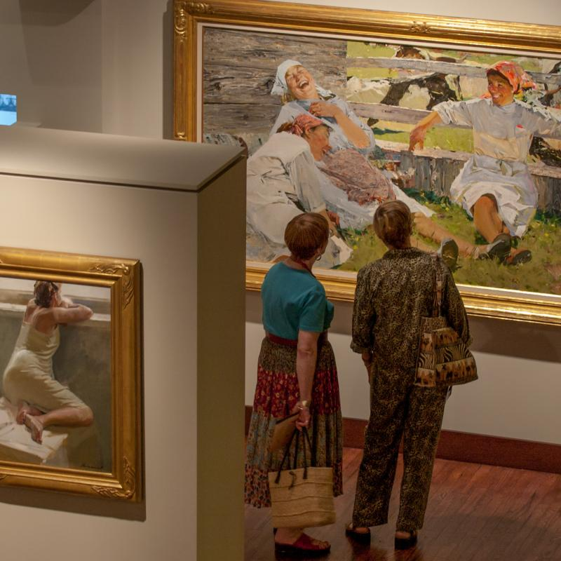 Two women looking at painting at Russian Art Museum in Minneapolis