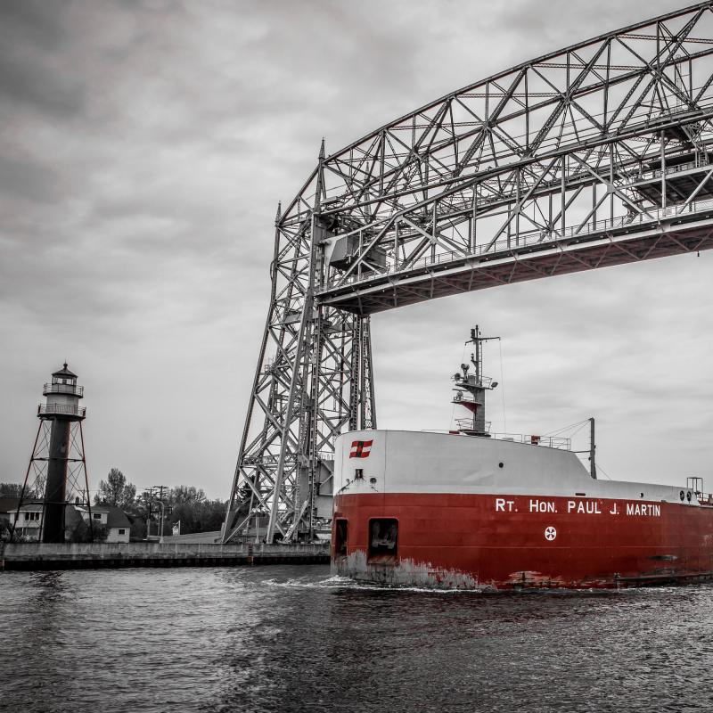 Ship passes beneath the Aerial Lift Bridge in Duluth