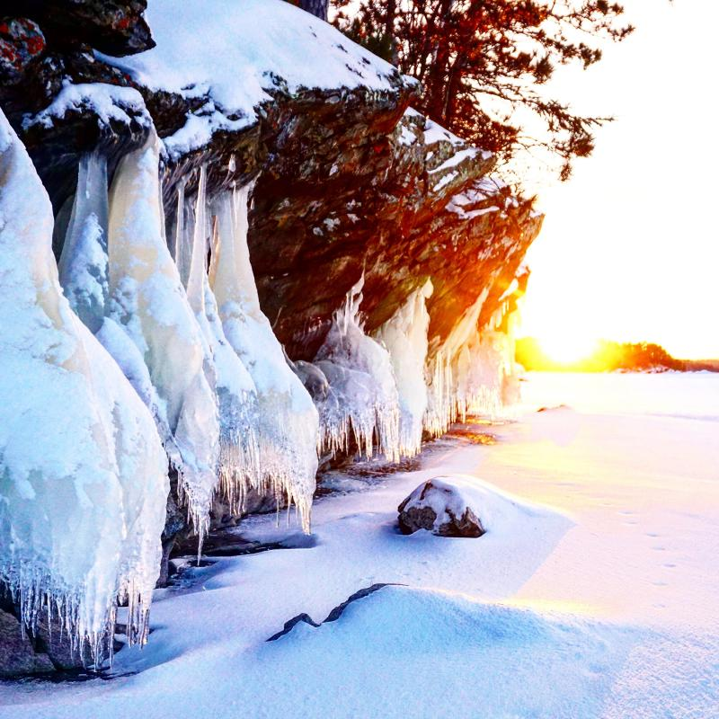 Sunrise over a snowy cliff in Voyageurs National Park