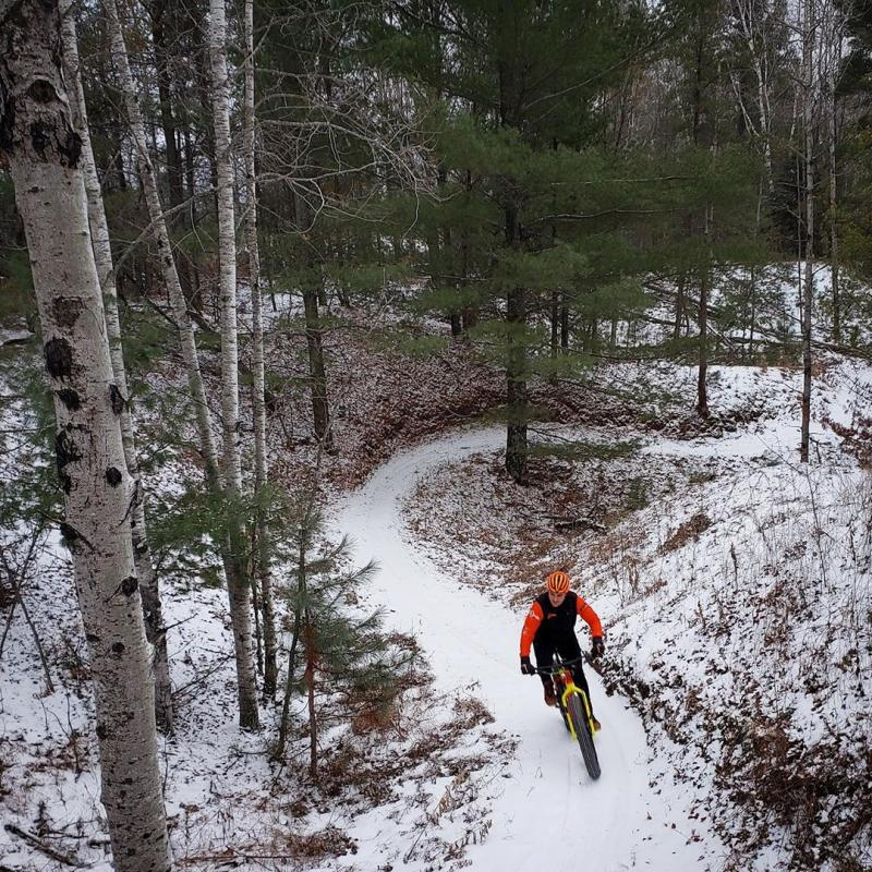 Winter fat biker on a trail at Cuyuna