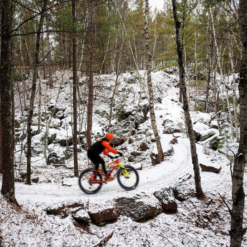 Winter fat biker climbs a hill at Cuyuna