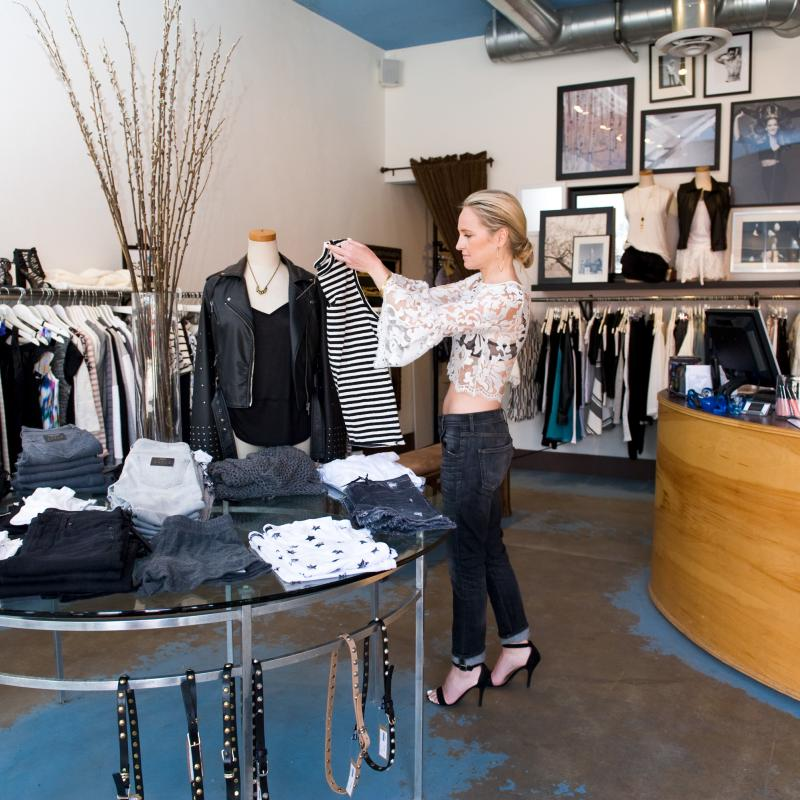 Woman in trendy clothing boutique in Edina