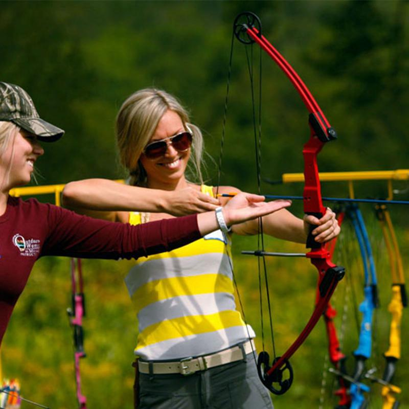 woman learning archery