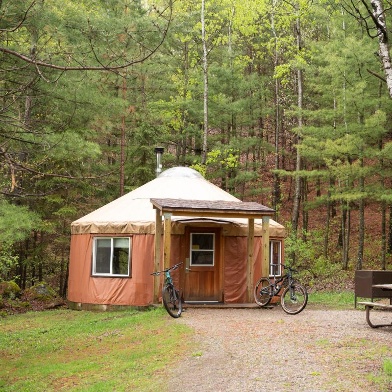 Two mountain bikes parked outside of a yurt in Cuyuna