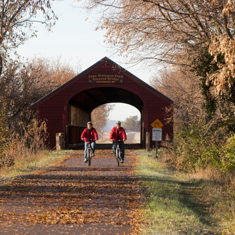 Couple biking Wobegon bike trail