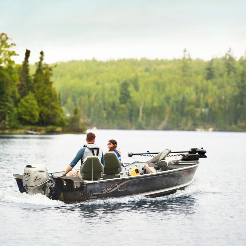 Father and daughter boating and fishing on Loon Lake