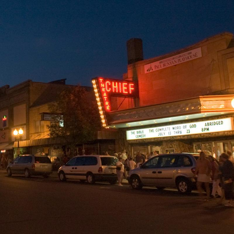 People leaving a performance at the Bemidji Chief Theater