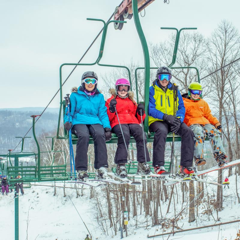 Family of skiers on chairlift