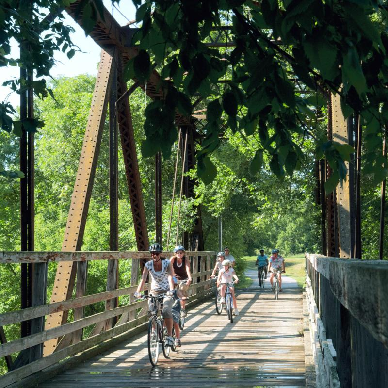 Biking over a bridge on the Root River Trail