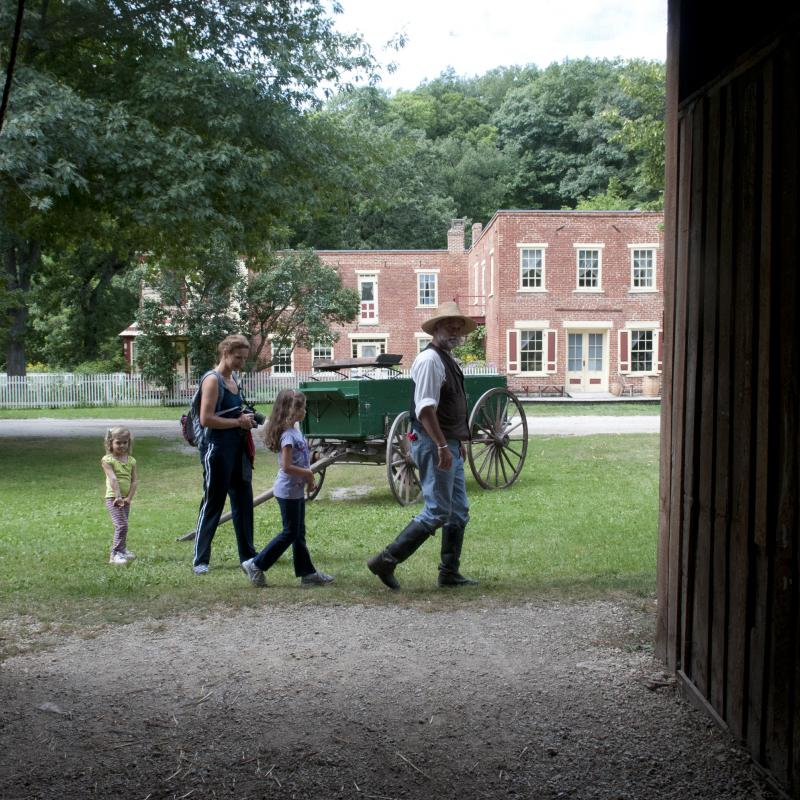 Family on a living history tour of Historic Forestville
