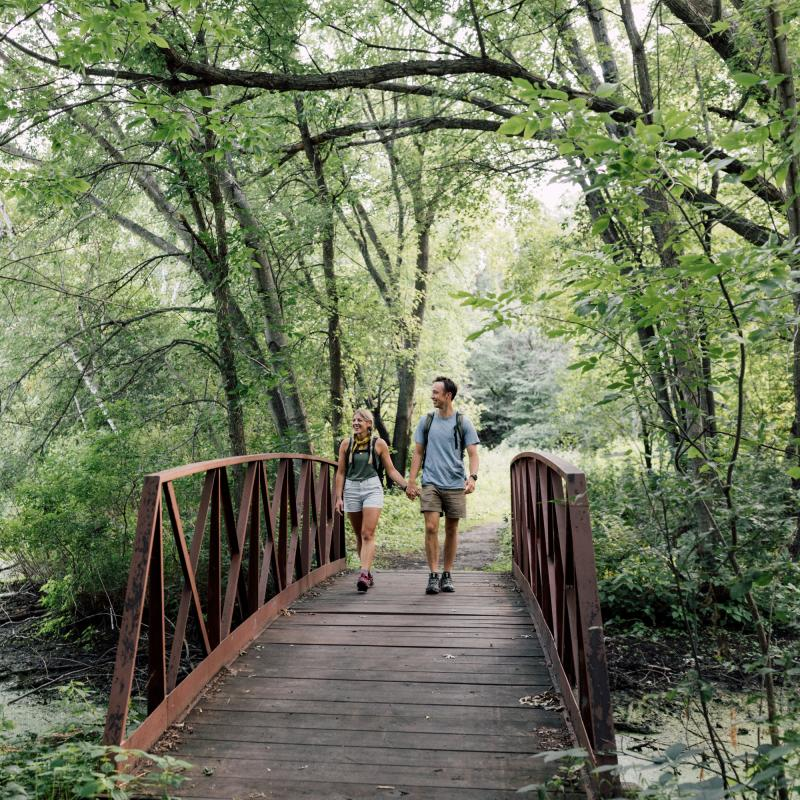 Couple hiking at Bunker Hills Regional Park in summer