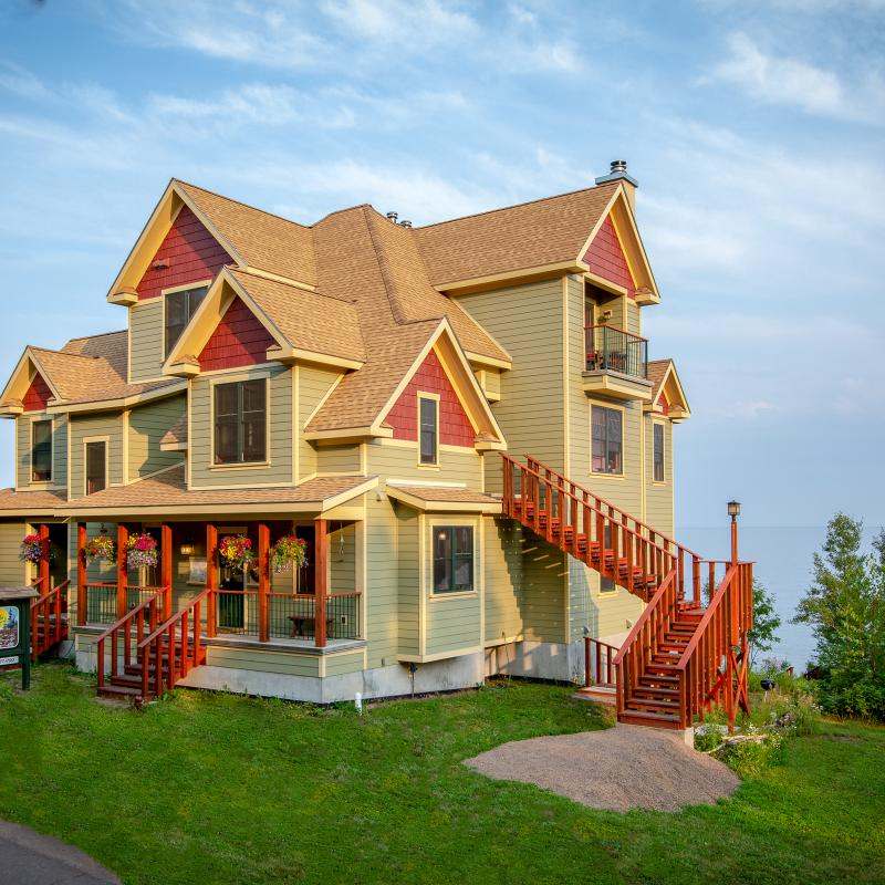 The stunning, green and red Croftville Road Cottages inn on Lake Superior